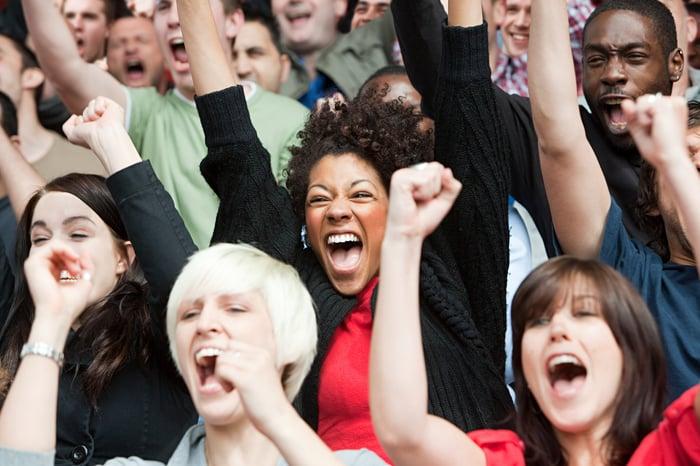 Crowd of people cheering.