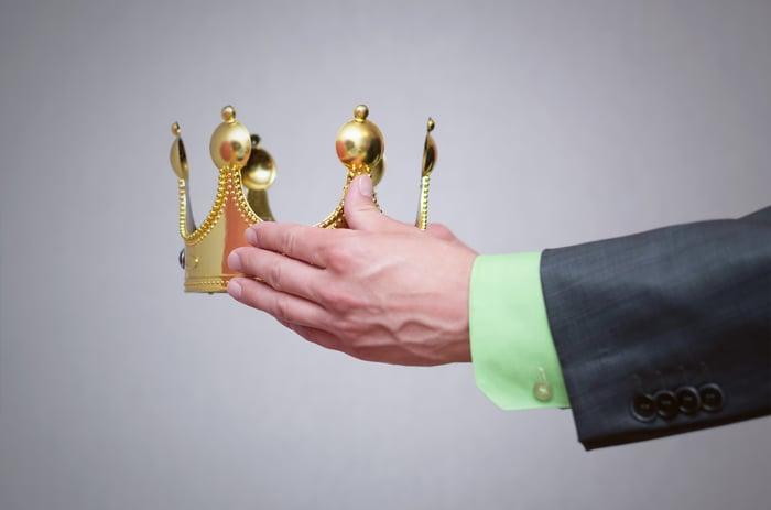 Businessman holding a golden crown