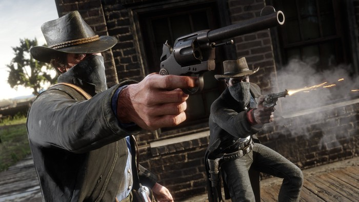 "A screenshot of Take-Two's ""Red Dead Redemption 2"" video game showing two characters dressed like cowboys firing a western-style revolver."