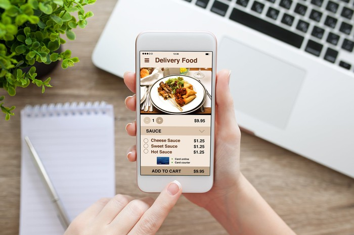 A food delivery app open on a smartphone