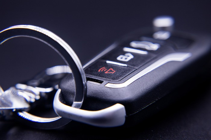 A close-up of an electronic automobile key fob.