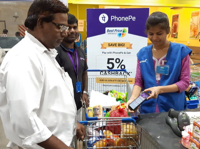 A man using PhonePe to buy groceries.