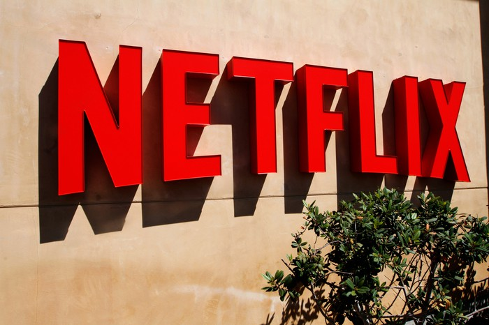 Red Netflix logo on a beige wall.