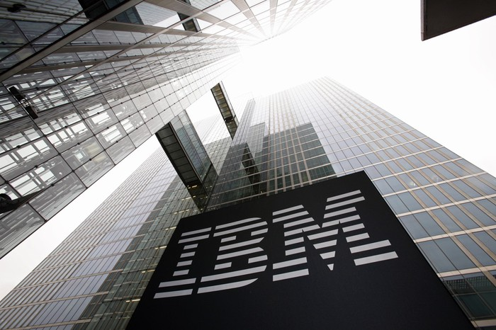 Skyscraper seen from ground level with IBM sign on the facade