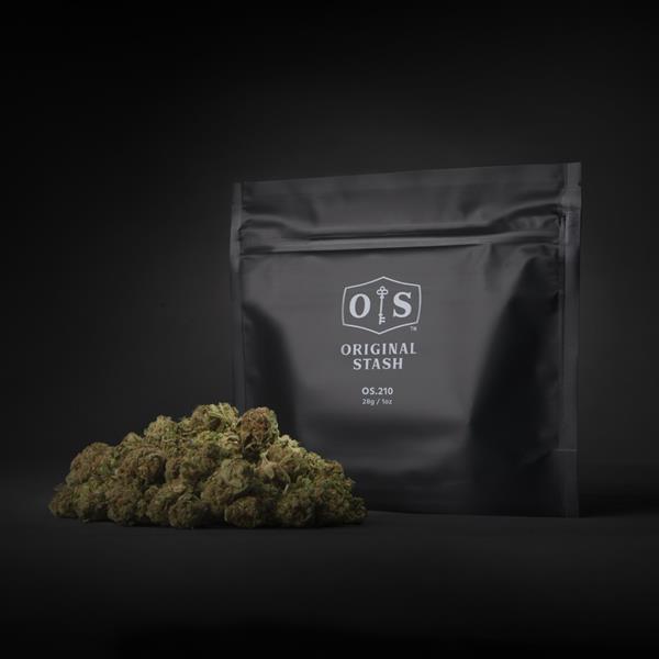 A pile of cannabis buds next to a black bag with HEXO's Original Stash logo.
