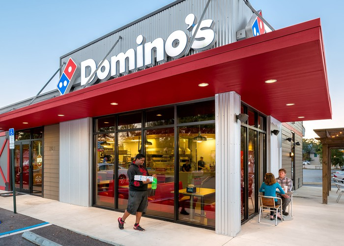 a Domino's Pizza storefront in Pensacola, Florida.