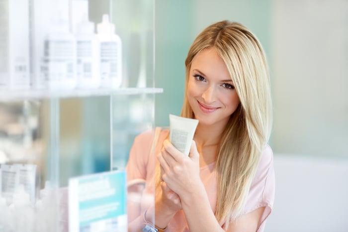 Woman choosing cosmetics