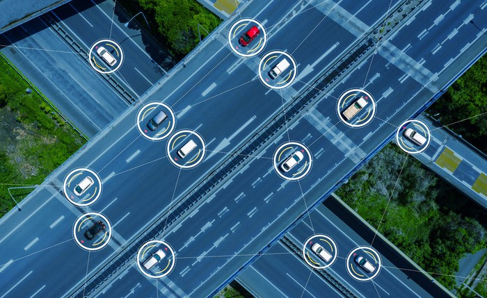 An overhead view of driverless vehicles on a freeway.
