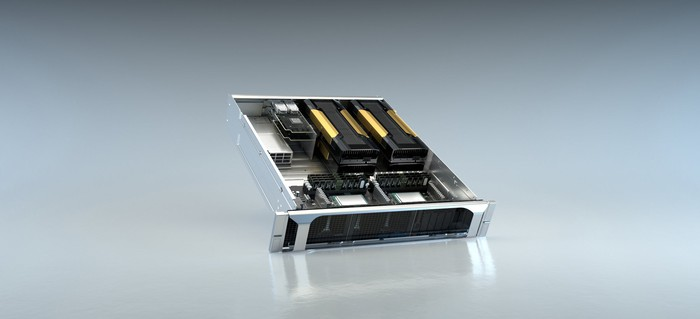 An NVIDIA EGX device: a silver box with several GPUs and other chips inside.