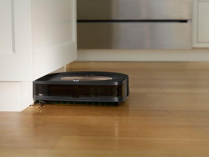 A Roomba vacuum cleaning hardwood floors.