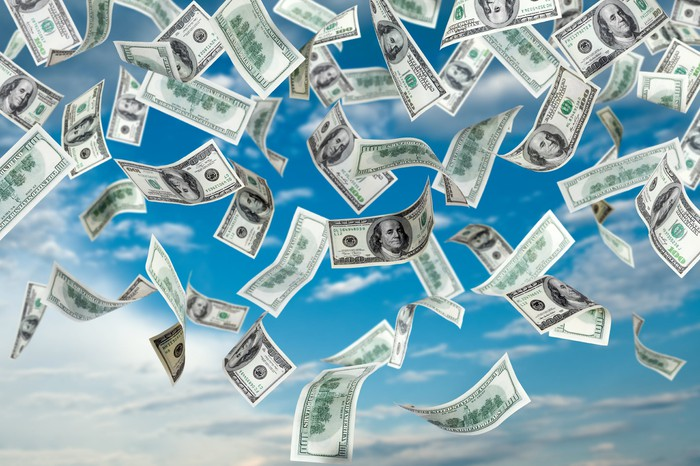 An illustration shows money raining from the sky.
