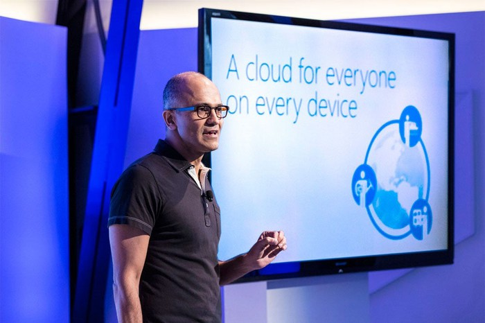 Microsoft CEO Satya Nadella standing in front of a screen that says a cloud for everyone on every device.