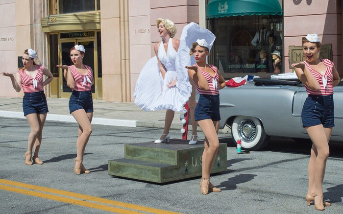 A Universal Studios theme park street show featuring a Marilyn Monroe lookalike and sporty sailor dancers.