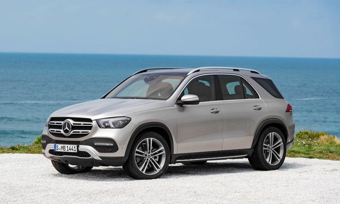 A silver 2019 Mercedes-Benz GLE, a five-passenger luxury SUV, parked on a beach.