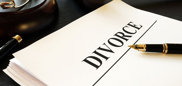 A paper with a pen laying on it that says Divorce