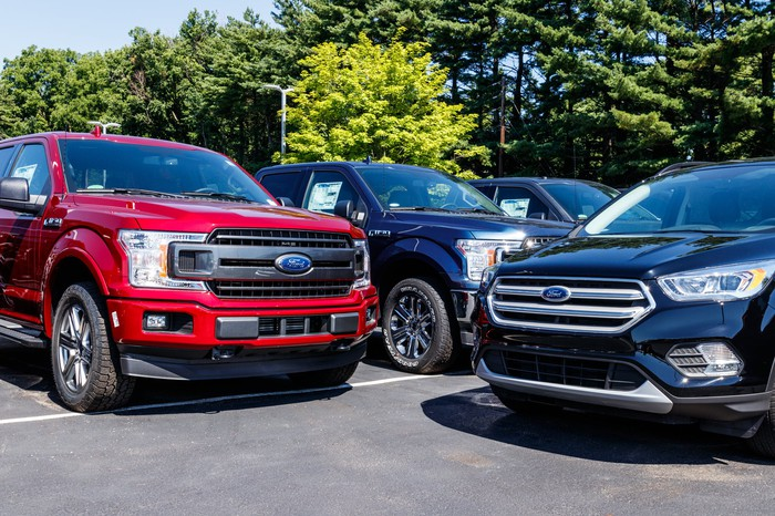 Ford vehicles on a dealer lot.