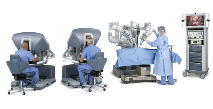 An array of da Vinci surgical systems being used by surgeons.