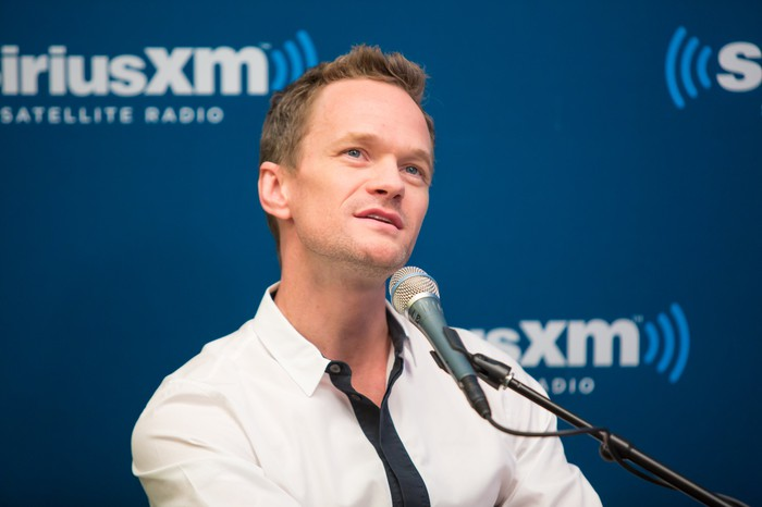Neil Patrick Harris thinking over a response at a Sirius XM Town Hall broadcast.