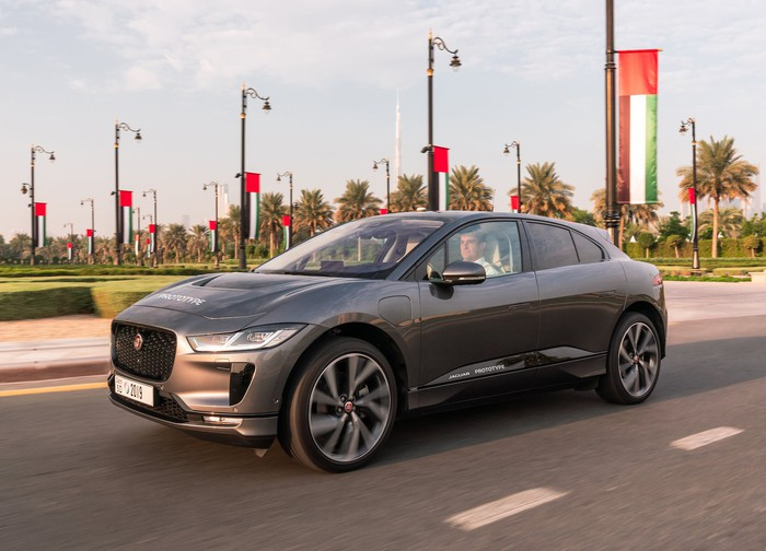 A silver Jaguar I-Pace, an upscale five-passenger electric crossover SUV.