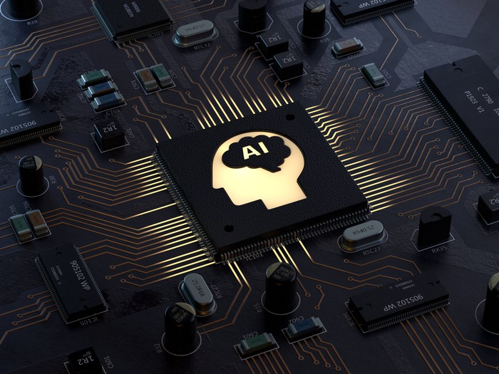 A black memory chip with a drawing of a human head in profile in the middle and the letters AI etched where the brain would be.