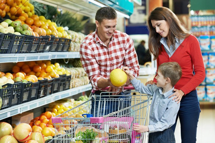 Family shopping in produce aisle