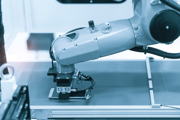 A robotic arm using machine vision in cell phone manufacturing.