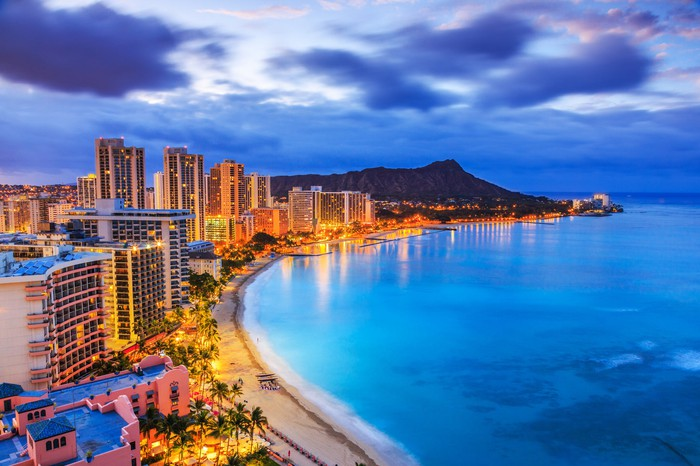 Honolulu's skyline and oceanfront seen at night.