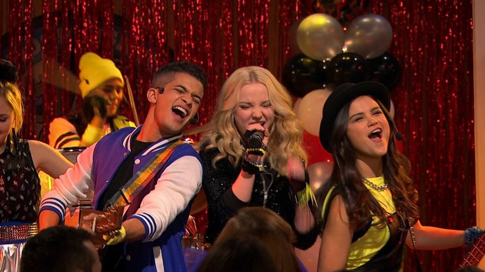 Disney Channel stars jamming in a fake concert on a Disney Channel show.
