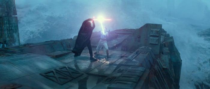 Rey and Kylo Ren having a lightsaber battle.