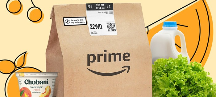 A brown paper bag with the Prime logo surrounded by groceries.
