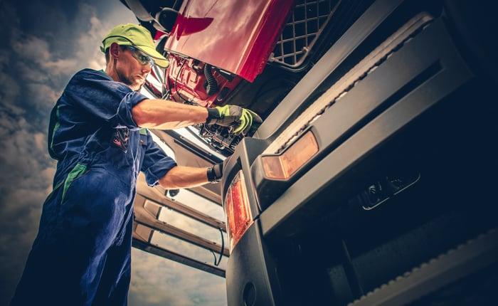 Man working on a semi truck