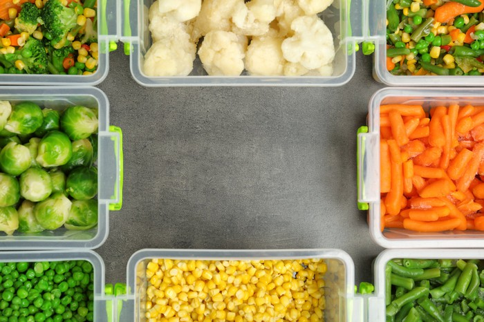 Various types of vegetables in eight food storage containers