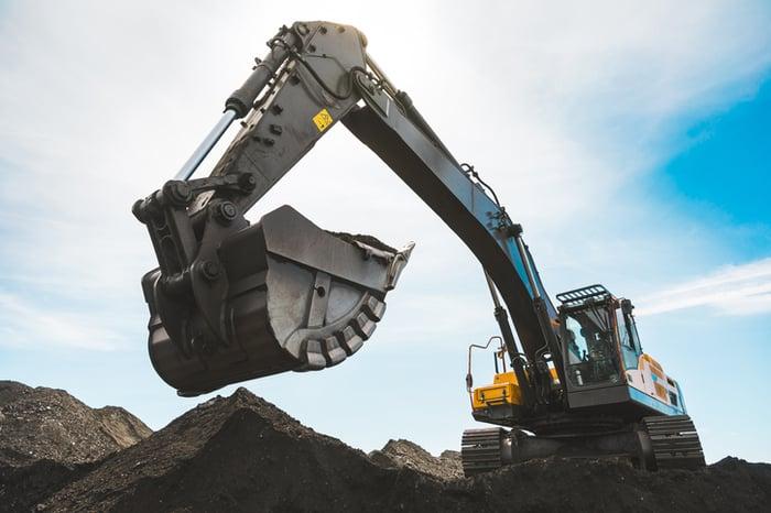 An excavator digging coal.