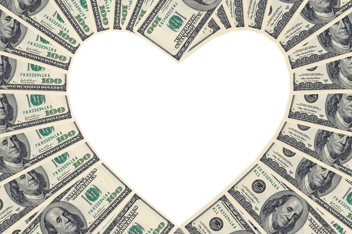 $100 bills forming the shape of a heart