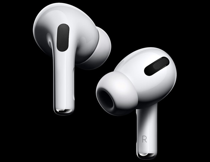 Apple's new AirPod Pro on black background.