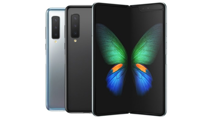 The Samsung Galaxy Fold smartphone, with the two halves unfolded to reveal a big OLED screen inside with the image of a butterfly.
