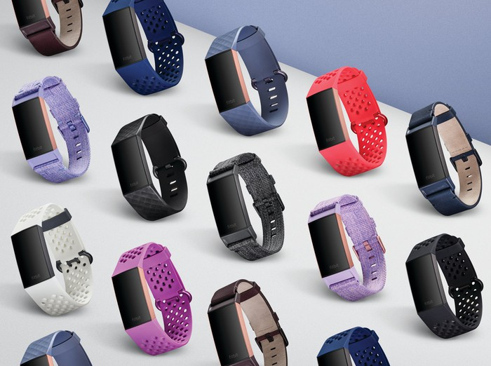 A lineup of Fitbits in various colors.