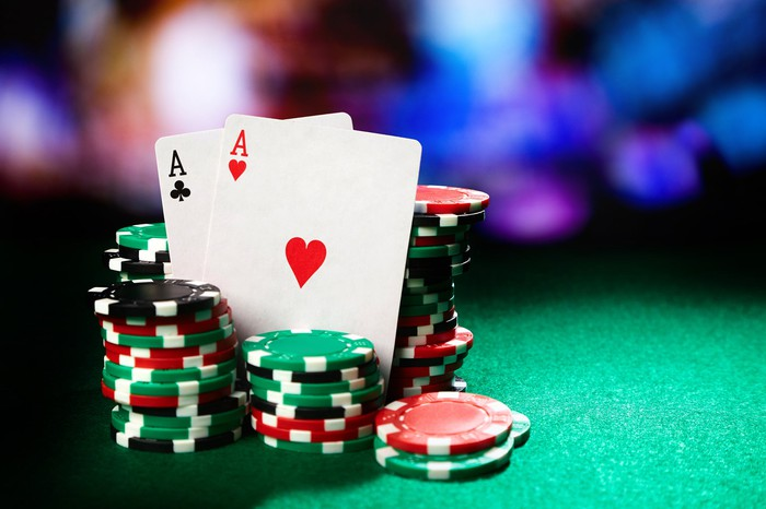 Stacks of poker chips and a pair of aces