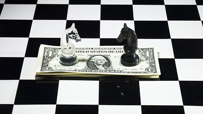 Black vs white chess knights on a dolla bill
