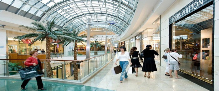 Shoppers visiting Taubman Centers' Mall at Millenia.