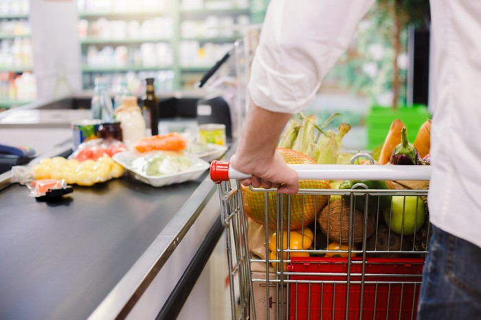 Man checking out with grocery cart