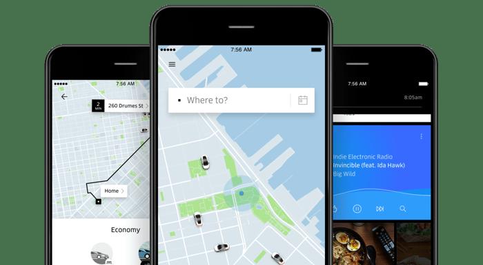Uber app displayed on three smartphones