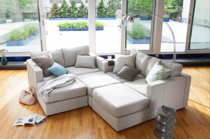 An assortment of couch sectionals pushed together in a living room.