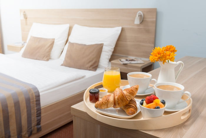 Close-up of a room service breakfast tray in a modern hotel room.