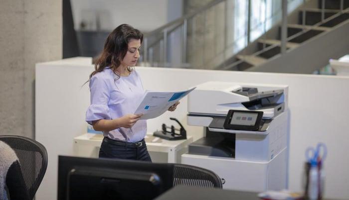 Woman using an HP printer