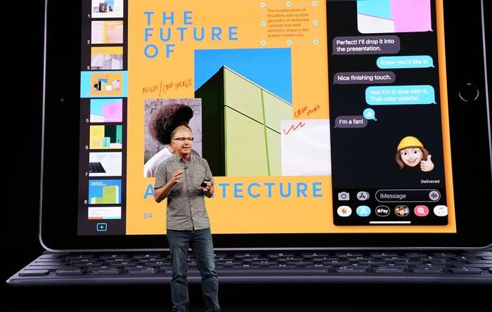 Greg Joswiak on stage unveiling the seventh-generation iPad