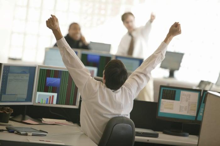 Triumphant stock trader.