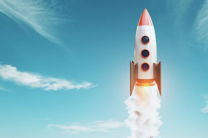 A toy rocket climbing through the sky.