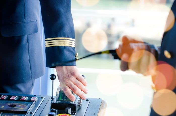 Close-up of a cruise ship captain at the controls of a modern vessel.