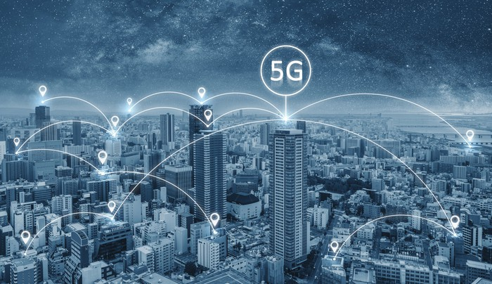 Cityscape with connected web of 5G icons floating above the buildings